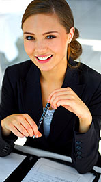 Photo of smiling young business woman with pen in her hand