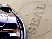 Closeup of seal stamped into paper with stamper